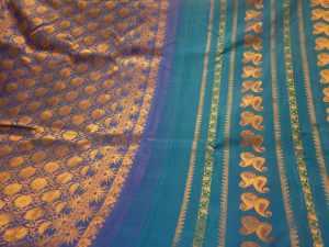 Close up of typical saris with the mango motif