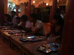 Folks sitting down for thali