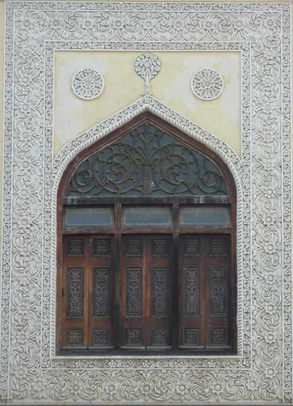 Intricately carved window at Chowmahalla