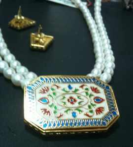 Pearls with traditional meenakari work