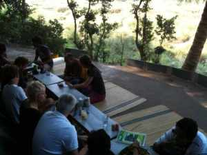 Terraces and low seating at mango tree