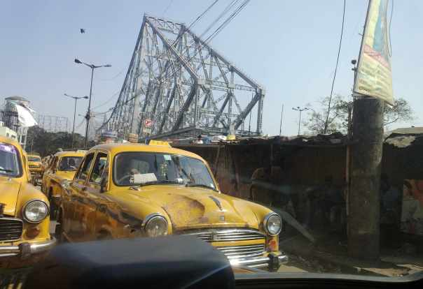 Yellow cab and Howrah bridge